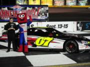 Jadan Walbridge of Vancouver stands in the winner's circle after a NASCAR Junior Late Model race this summer in Las Vegas.