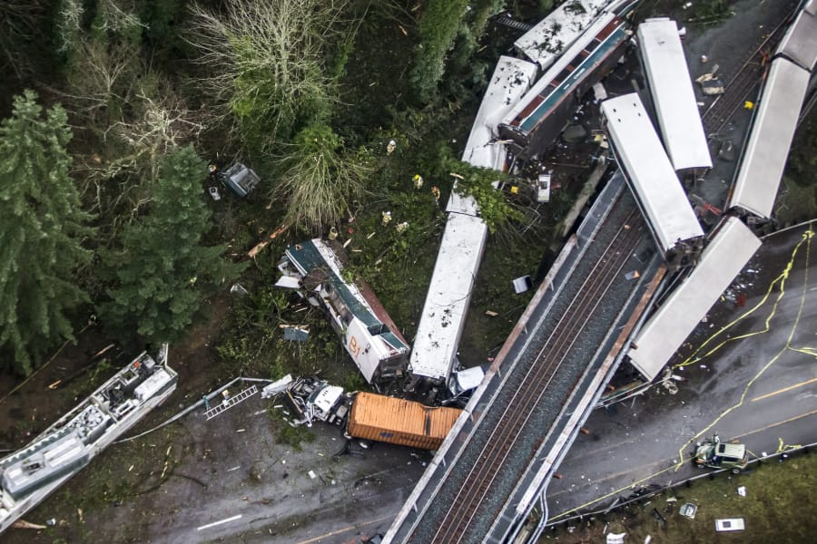 Cars from an Amtrak train lie spilled onto Interstate 5 near DuPont on Dec. 18, 2017.