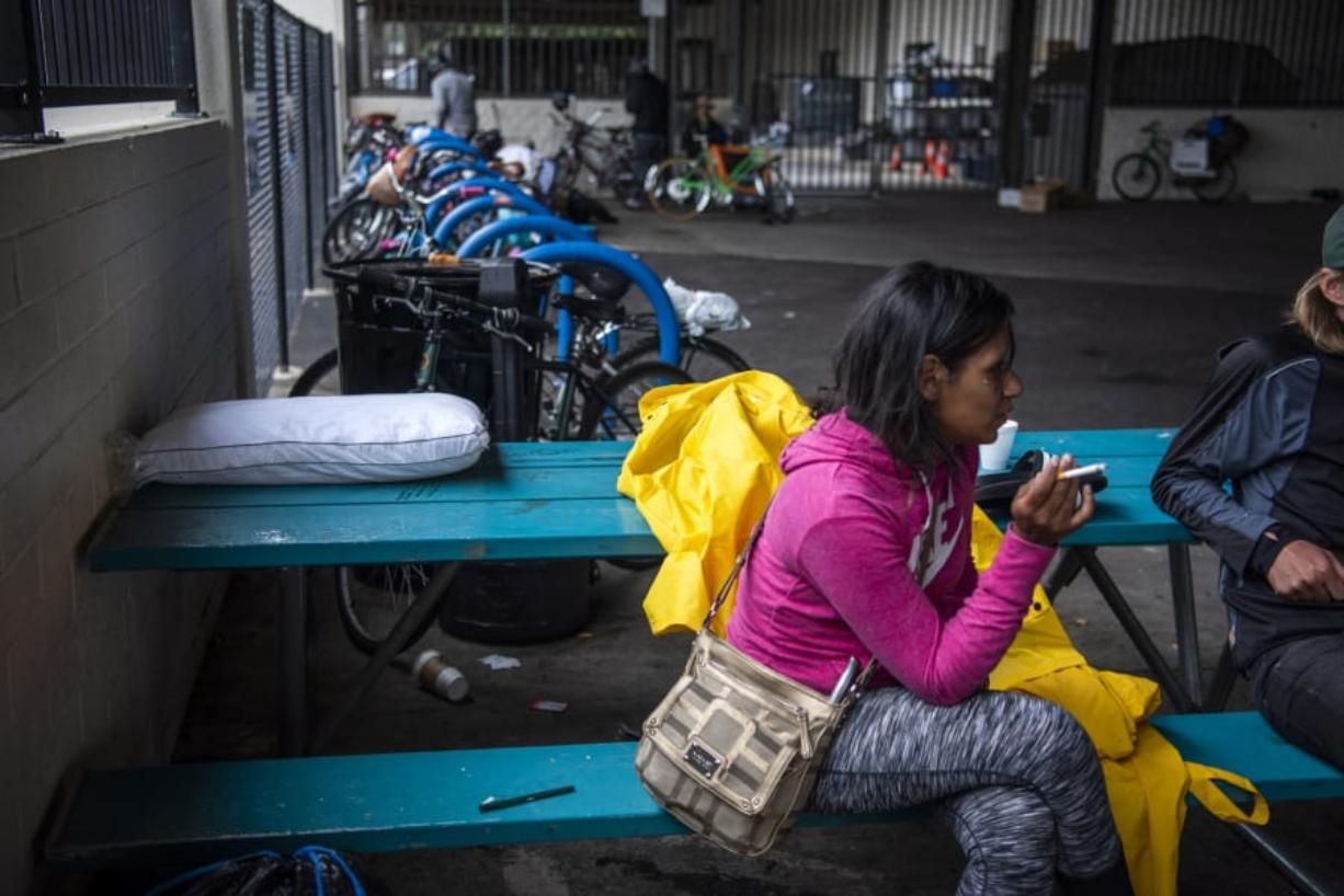 Chynna Lee smokes outside the Vancouver Navigation Center on June 27. Lee said she has been homeless for a few years and was a frequent patron of the center.