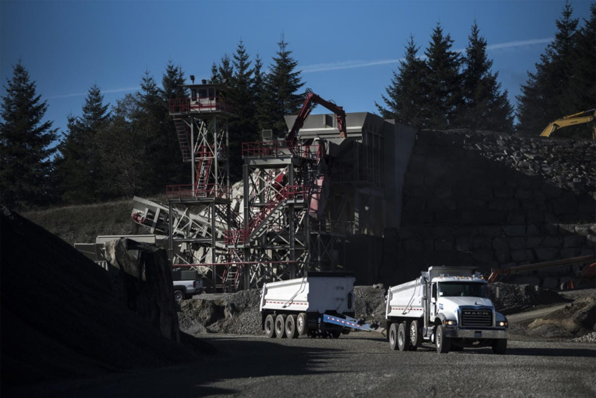 A truck hauls gravel across the quarry on Yacolt Mountain. The gravel is in demand, but nearby residents take a dimmer view of the mine.