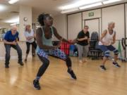"""Certified fitness instructor Amie Sowe, 25, leads a 50-minute African dance class at the Touchmark Health & Fitness Club on Mondays and Wednesdays. Sowe has worked at the facility since 2016 and enjoys channeling love of her home country — The Gambia — into the class. """"Here are some moves to help your back, or your balance. That's how I molded it. Just to showcase me and who I am. This is me,"""" she said."""