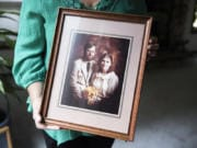Fay Blackburn holds a photograph from her wedding to Reid Blackburn, a Columbian photographer who died while covering the 1980 Mount St. Helens eruption.
