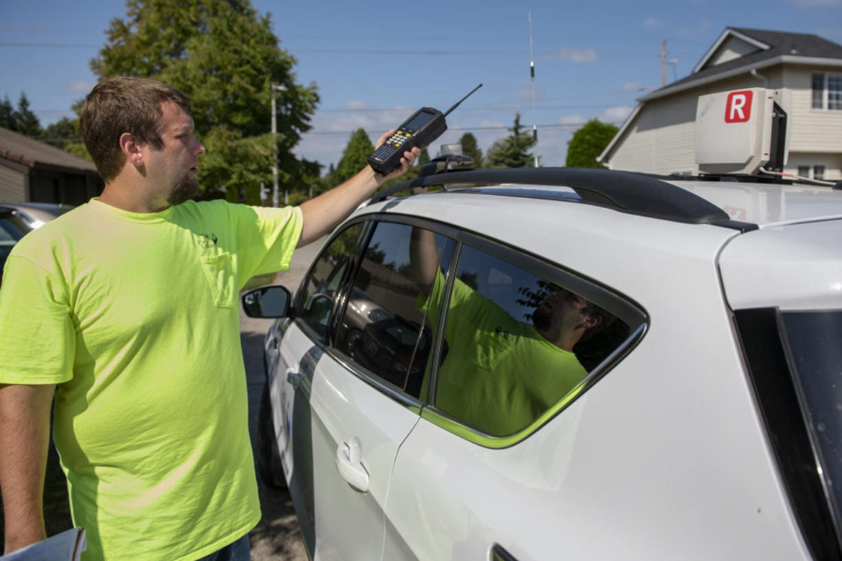 Joe Cryblskey, a Clark Public Utilities AMR (automated meter reading) driver, explains how the automated meter reading is used to track customer usage, while covering his route in the Salmon Creek neighborhood.