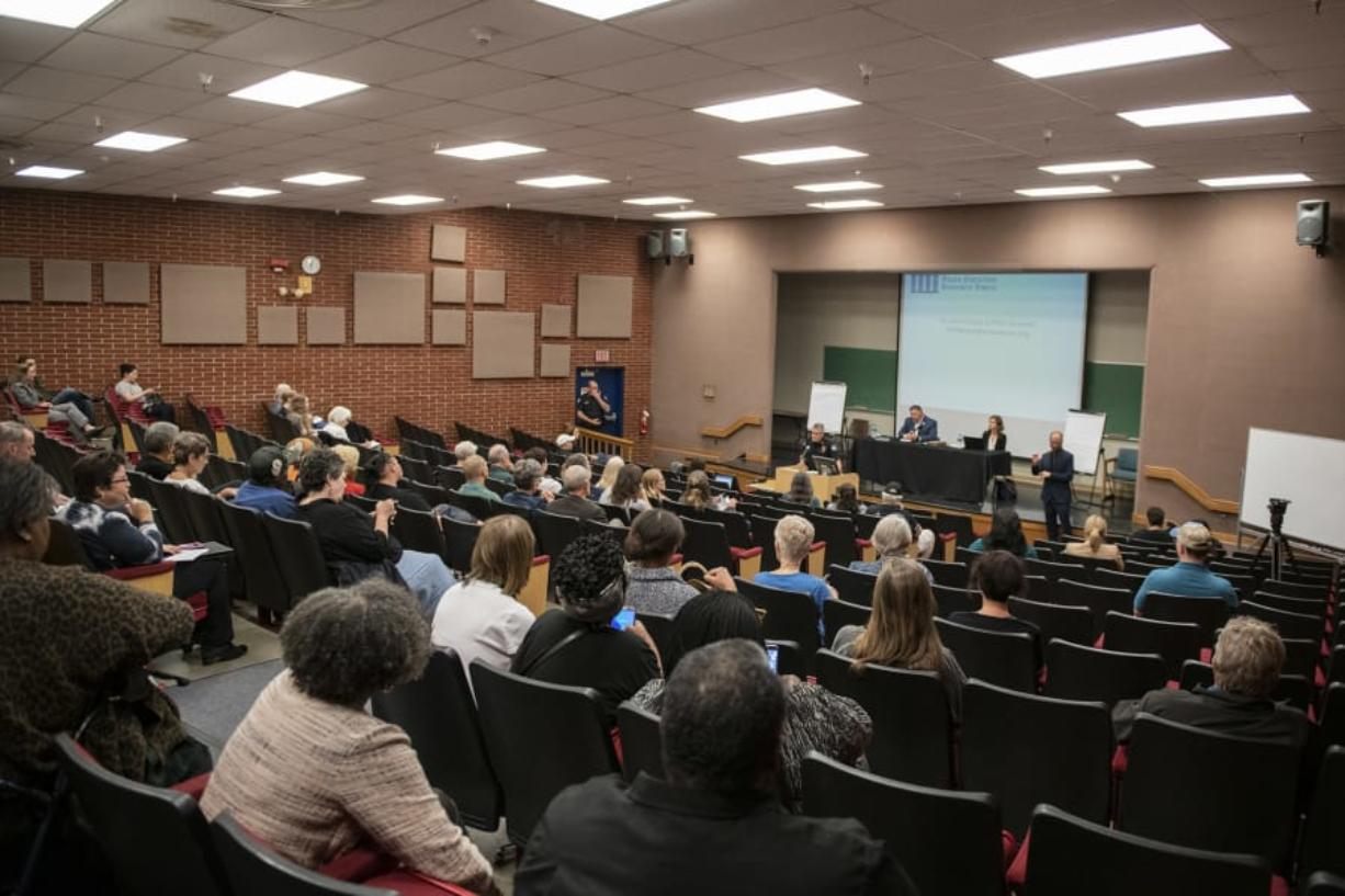 People gather Wednesday evening for a forum on the Vancouver Police Department's use-of-force policies in the auditorium at Clark College's Foster Hall. Zach Wilkinson/The Columbian
