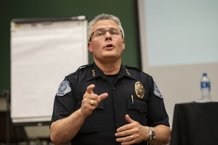 Vancouver Police Chief James McElvain speaks with an audience member during a forum on the department's use-of-force policies in September 2019 evening at Clark College's Foster Hall.