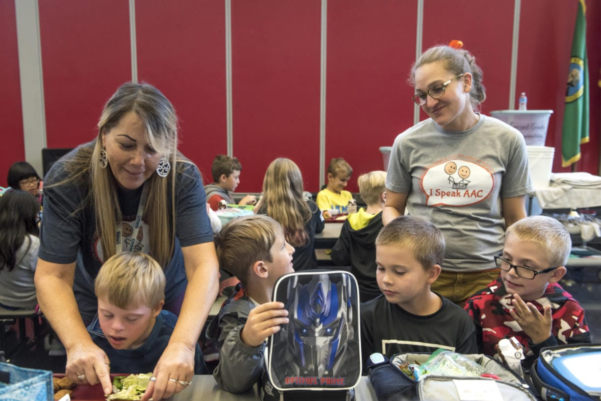 Amy Campbell, standing at right, is a special education teacher at Helen Baller Elementary School and the 2020 Washington State Teacher of the Year. Campbell, seen visiting with students at lunch period Monday, said she is focused on including her special education students in with the rest of the school to build community, empathy and relationships.