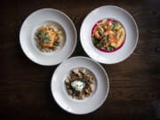 The Columbia River steelhead, clockwise from left, the Pacific prawns and the braised shortrib stroganoff at Skamania Lodge's Cascade Dining Room in Stevenson.