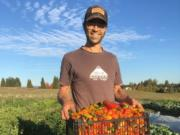 Co-owner Patrick Dorris showcases the bounty of Flat Tack Farms, which is hosting a farm-to-table dinner Sept. 21.