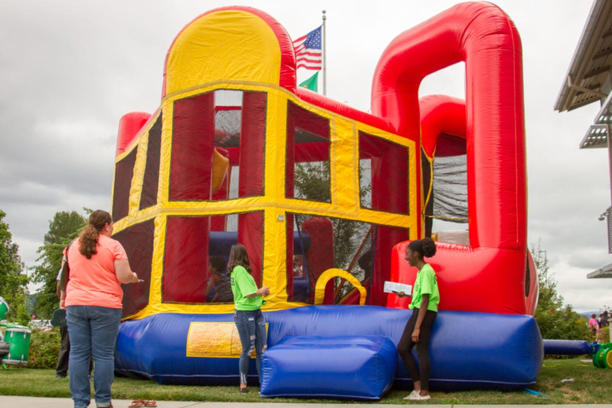 In addition to handing out backpacks filled with school supplies, Woodland Public Schools' third annual Back to School Bash also allowed kids to play in bounce houses.