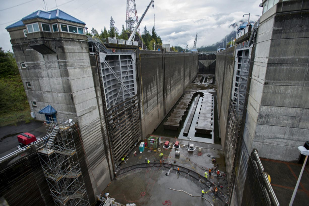 Contracted workers from Advanced American Construction work to replace the sill at Bonneville Navigation Lock on Wednesday morning. The U.S. Army Corps of Engineers hosted a tour at the lock to show off the emergency repair project.
