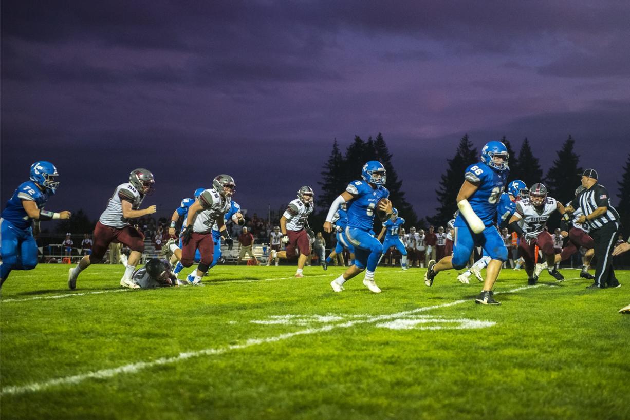 La Center Quarterback Tom Lambert runs the ball against Hoquiam at La Center High School on Friday night, Sept. 20, 2019.