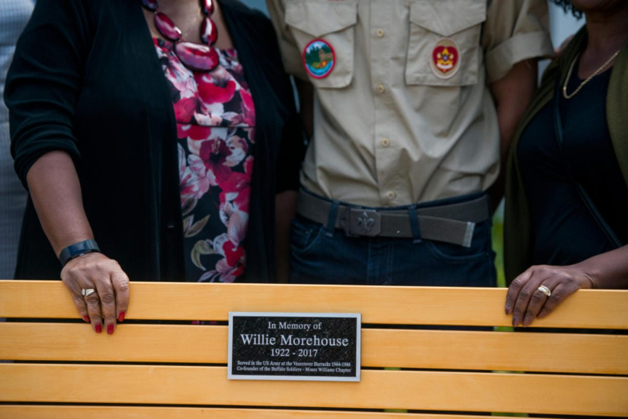 Wilson Keller, center stands for a picture with family members of Willie Morehouse behind a bench dedicated to him after a service for a new memorial for Buffalo Soldiers at the Fort Vancouver infantry barracks on Saturday, September 21, 2019. The memorial was the project of local Eagle Scout, Wilson Keller.