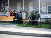 Wilson Keller cuts the ribbon for his Eagle Scout project with family members of Willie Morehouse, who served as a Buffalo Soldier, at the Fort Vancouver infantry barracks on Saturday, September 21, 2019. Keller's project was a memorial for Buffalo Soldiers who served in the American West.