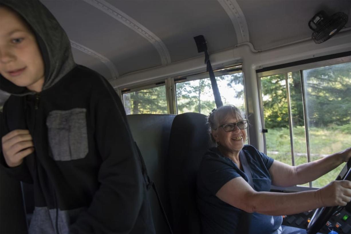 Debbie Proctor says goodbye to students as they get off her Green Mountain Elementary School bus in Woodland on her Wednesday afternoon route. Known as Ms. Debbie to students, Proctor, 65, is on her 34th year of driving for the school, which is the only school in its district.