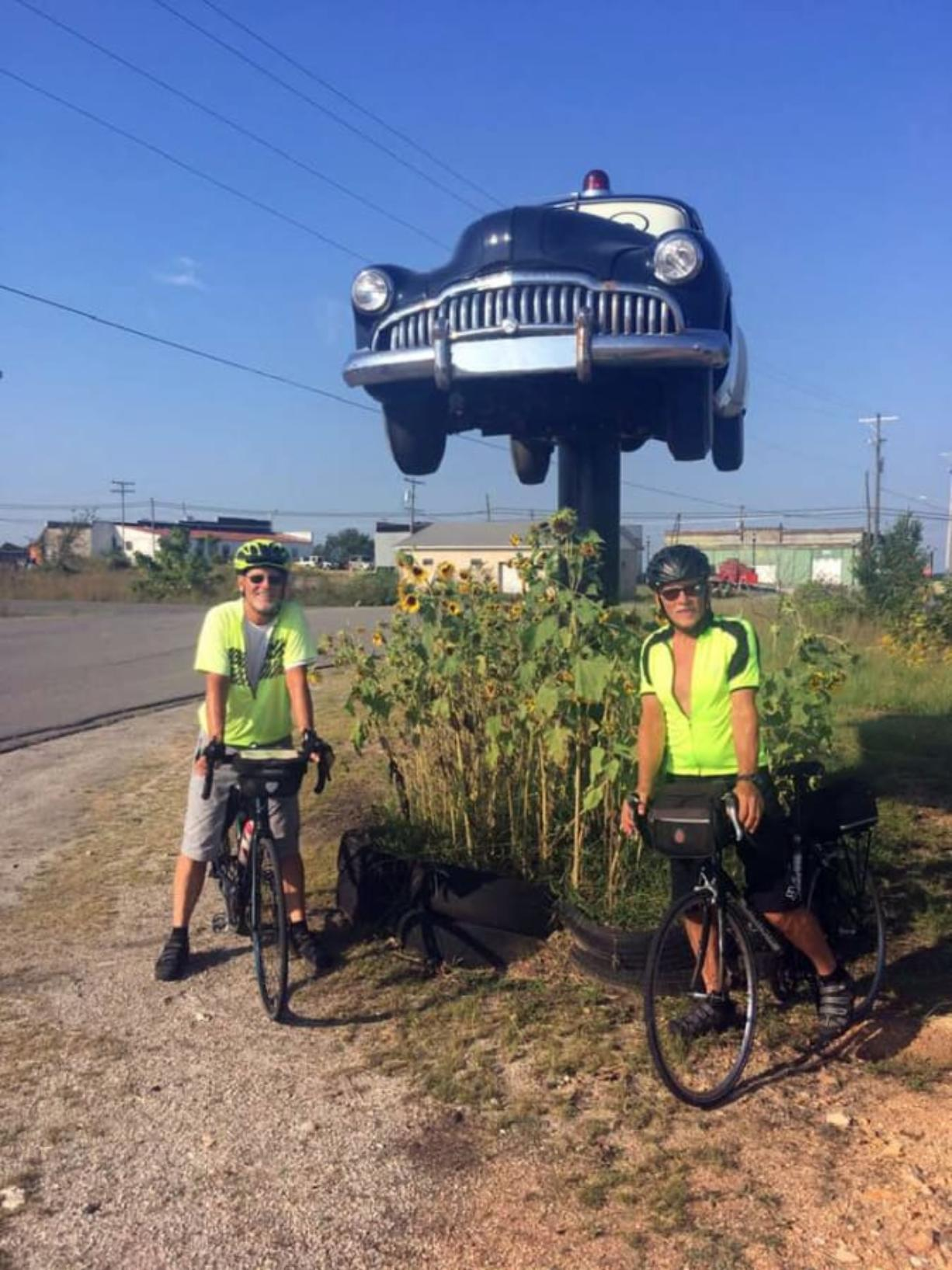Brothers Mike, left, and Mark Roskam pose for a photo in Kansas during their cross-country cycling journey to raise funds for Open House Ministries. The trip was cut short after Mike Roskam was struck by a pickup in Oklahoma. (Contributed photo)