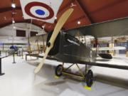 "A A 1918 Curtiss JN-4 ""Jenny"" airplane that was dedicated as part of the exhibit at Pearson Air Museum on Saturday. Its paint scheme replicates an airplane that flew from Pearson Field in the early 1920s as part of the U.S. Army Air Reserve's 321st Observation Squadron."
