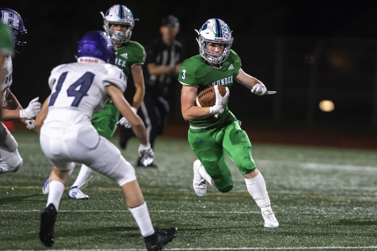 Mountain View's Alec Cann runs the ball against Heritage during a game at McKenzie Stadium on Friday night, Sept 27, 2019.