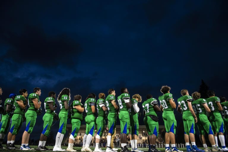 Mountain View lines up for the national anthem before their game against Heritage at McKenzie Stadium on Friday night, Sept 27, 2019. (Nathan Howard/The Columbian)