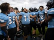Hockinson players let our a roar before Friday nightÕs game in Hockinson on Sept. 13, 2019. The HawkÕs lost 21-27.