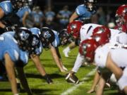 Hockinson and Archbishop Murphy face off at the line of scrimmage during Friday nightÕs game in Hockinson on Sept. 13, 2019. The HawkÕs lost 21-27.