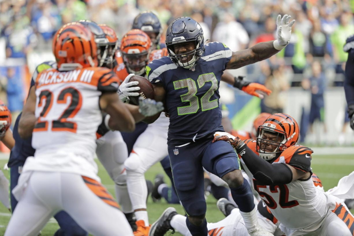 Seattle Seahawks running back Chris Carson (32) rushes against the Cincinnati Bengals during the second half of an NFL football game, Sunday, Sept. 8, 2019, in Seattle.