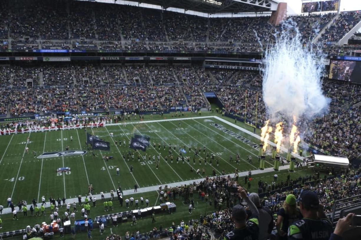 Fire effects go off as Seattle Seahawks players run out of the tunnel at the start of their home opener NFL football game against the Cincinnati Bengals at CenturyLink Field, Sunday, Sept. 8, 2019, in Seattle.