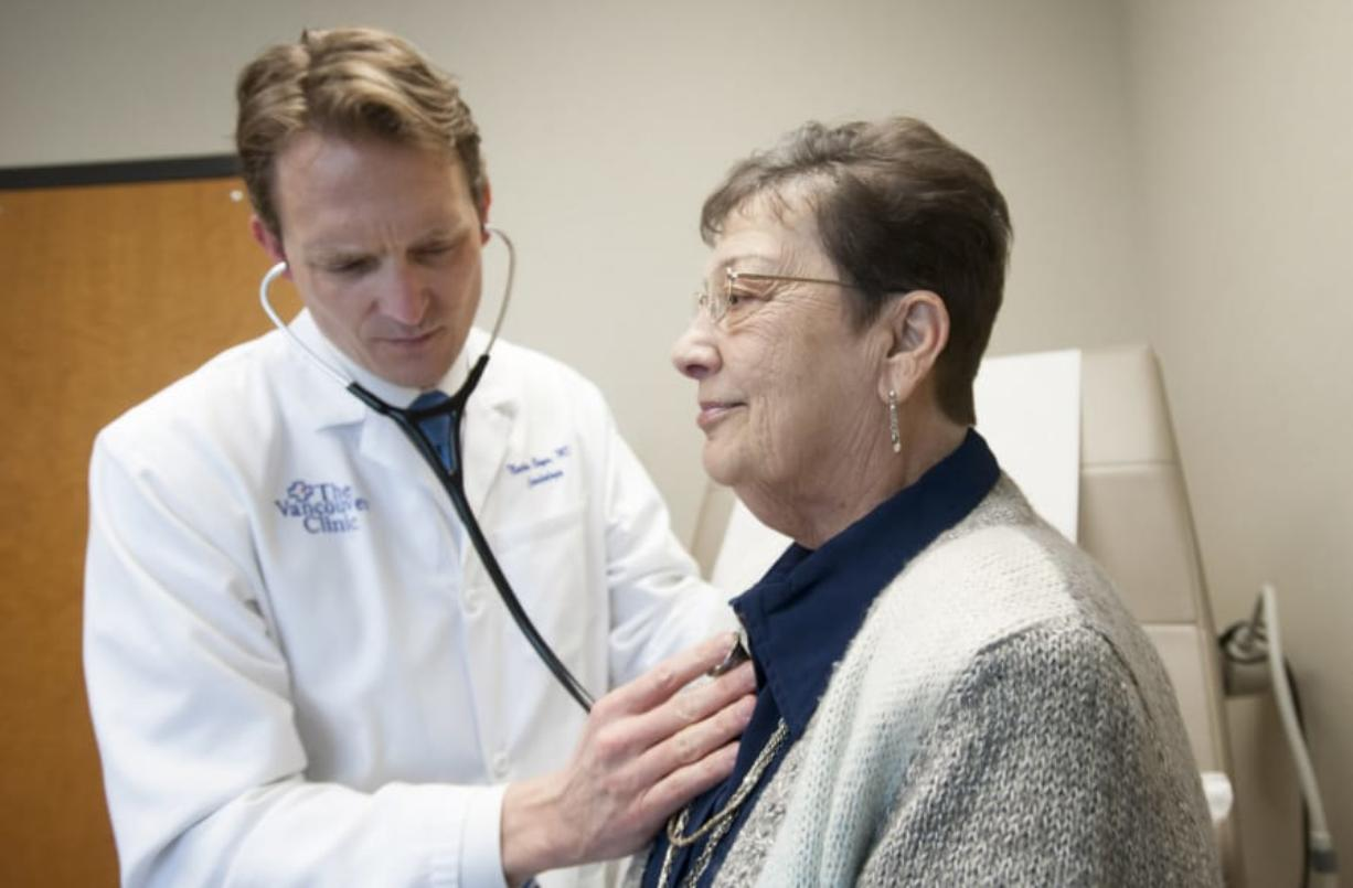 Cardiologist Dr. Nathan Boyer follows up with patient Sharon Parks at Vancouver Clinic in 2016. Parks, 69, was the first patient in Clark County to undergo a new cardiac procedure called TAVR. The procedure was initially only available to the most high-risk patients, but has been expanded to all risk levels. The Columbian files