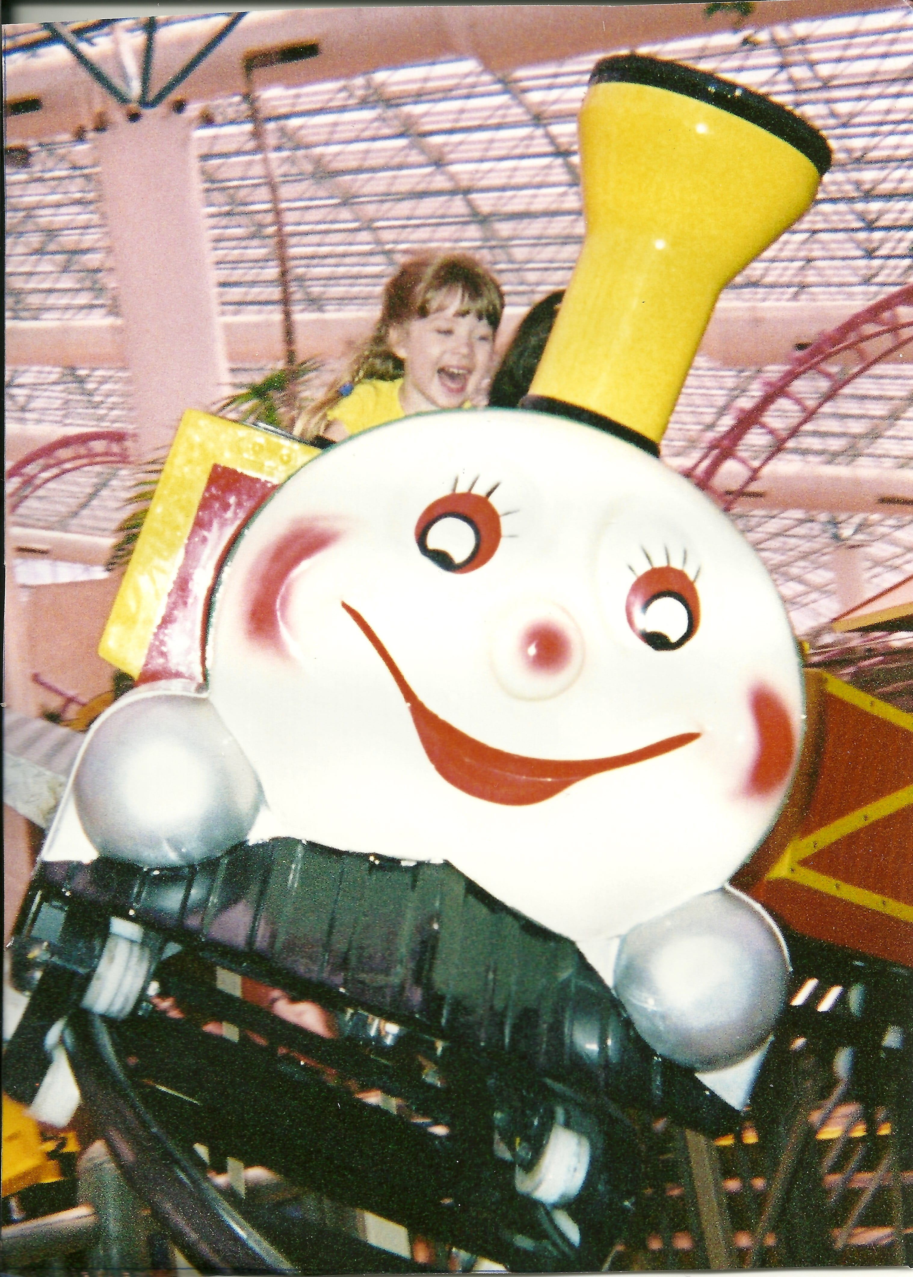 Pure Joy on the face of my granddaughter Sophie riding the roller coaster at Circus Circus in Las Vegas; in 2002 when she was 4 years old. Picture taken by Victoria Moy (grandmother). Photo by Victoria Moy