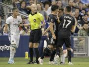 Sporting Kansas City midfielder Roger Espinoza (17) grabs Portland Timbers midfielder Sebastian Blanco (10), second from right during a scuffle in the first half of an MLS soccer game Sunday, Sept. 29, 2019, in Kansas City, Kan.