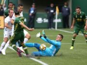 Minnesota United FC goalkeeper Vito Mannone (1) makes a save against Portland Timbers'  Diego Valeri (7) during an MLS soccer match at Providence Park, Sunday, Sept. 22, 2019, in Portland, Ore.
