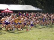 Runners take off from the start line of the Division I boys race at Nike Portland XC cross country meet at Blue Lake Regional Park in Fairview, Ore.