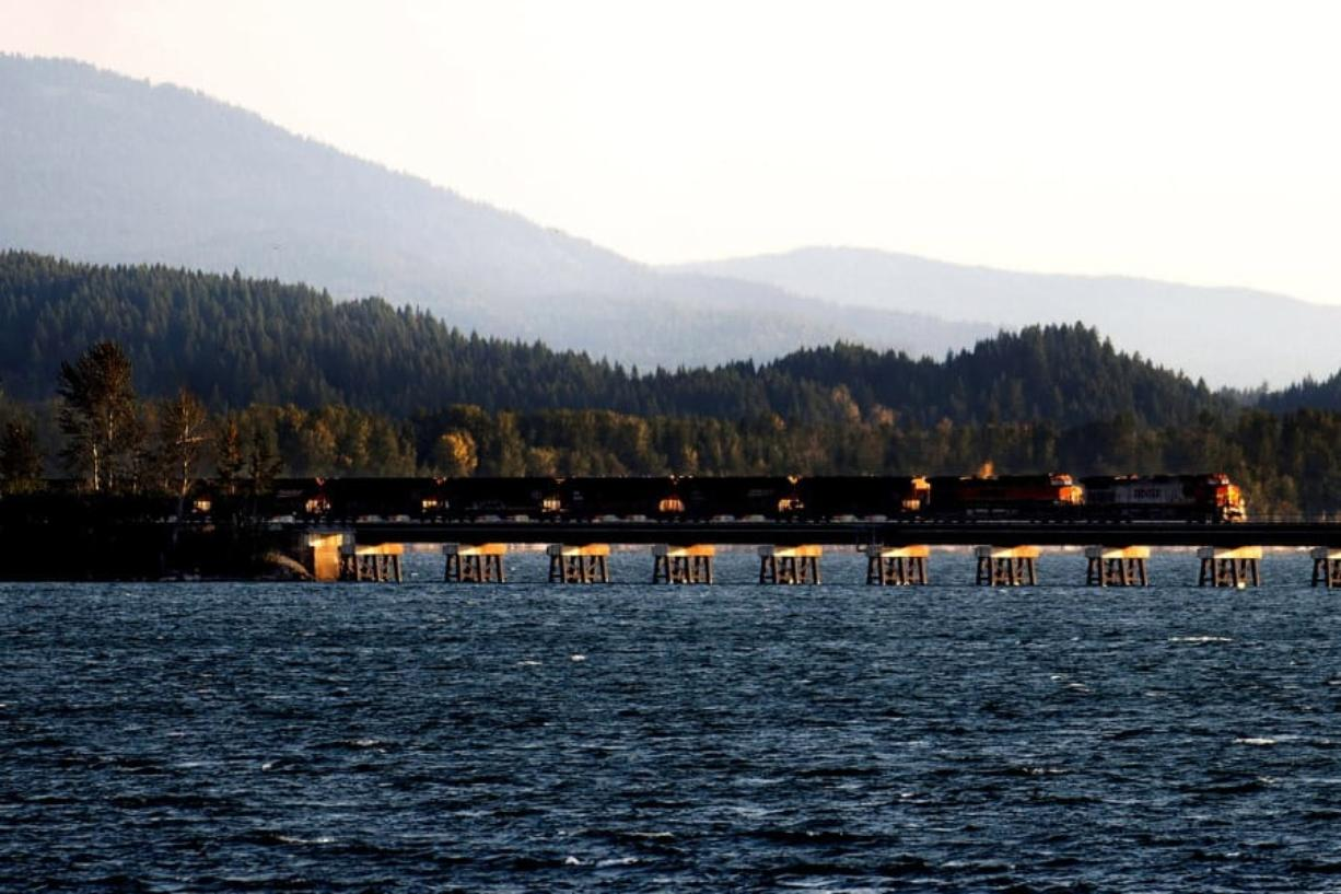 A train crosses Lake Pend Oreille on Sept. 16, 2014, as it leaves Sandpoint, Idaho. Kathy Plonka/The Spokesman-Review files