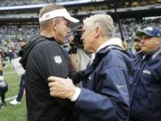 New Orleans Saints head coach Sean Payton, left, talks with Seattle Seahawks head coach Pete Carroll, right, after an NFL football game, Sunday, Sept. 22, 2019, in Seattle. (AP Photo/Ted S.
