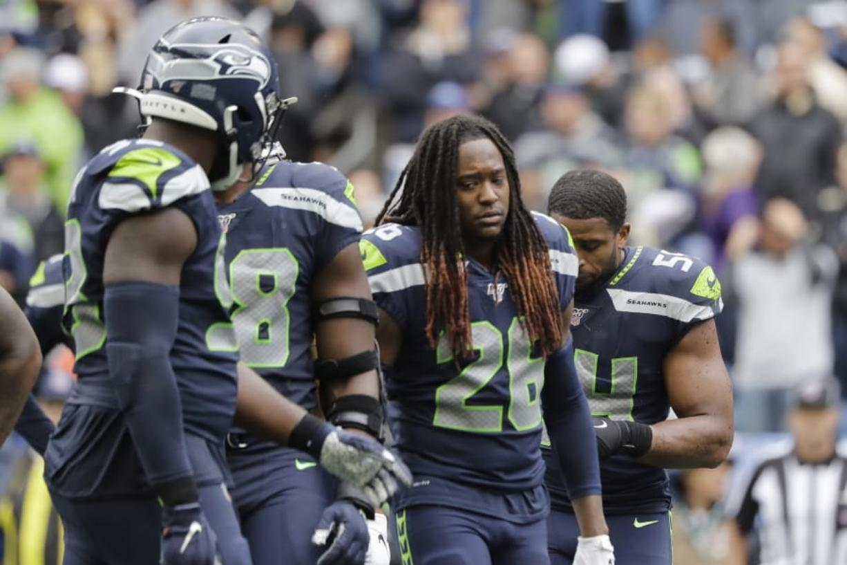 Seattle Seahawks' Shaquill Griffin (26) and teammates walk off the field late in the second half of an NFL football game against the New Orleans Saints, Sunday, Sept. 22, 2019, in Seattle. (AP Photo/Ted S.