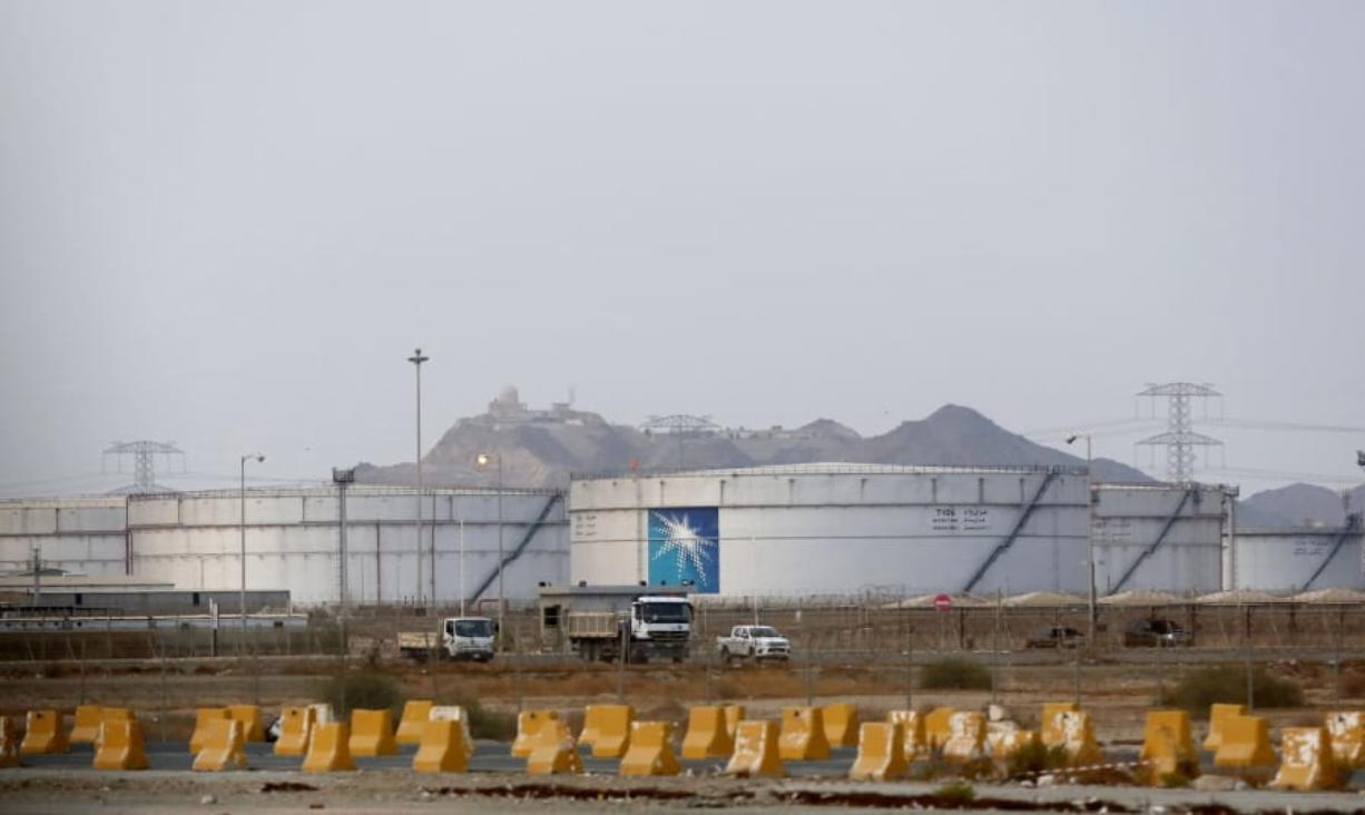 Storage tanks are seen at the North Jiddah bulk plant, an Aramco oil facility, in Jiddah, Saudi Arabia, Sunday, Sept. 15, 2019. The weekend drone attack in Buqyaq on one of the world's largest crude oil processing plants that dramatically cut into global oil supplies is the most visible sign yet of how Aramco's stability and security is directly linked to that of its owner -- the Saudi government and its ruling family.