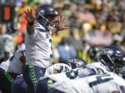 Seattle Seahawks quarterback Russell Wilson (3) calls signals against the Pittsburgh Steelers in the first half of an NFL football game, Sunday, Sept. 15, 2019, in Pittsburgh. (AP Photo/Gene J.