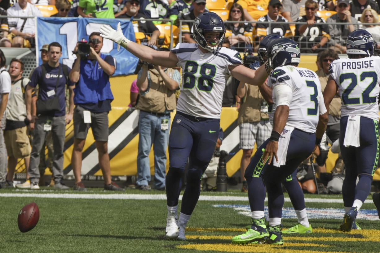 Seattle Seahawks tight end Will Dissly (88) celebrates with quarterback Russell Wilson (3) after making a touchdown catch against the Pittsburgh Steelers in the first half of an NFL football game, Sunday, Sept. 15, 2019, in Pittsburgh. (AP Photo/Gene J.
