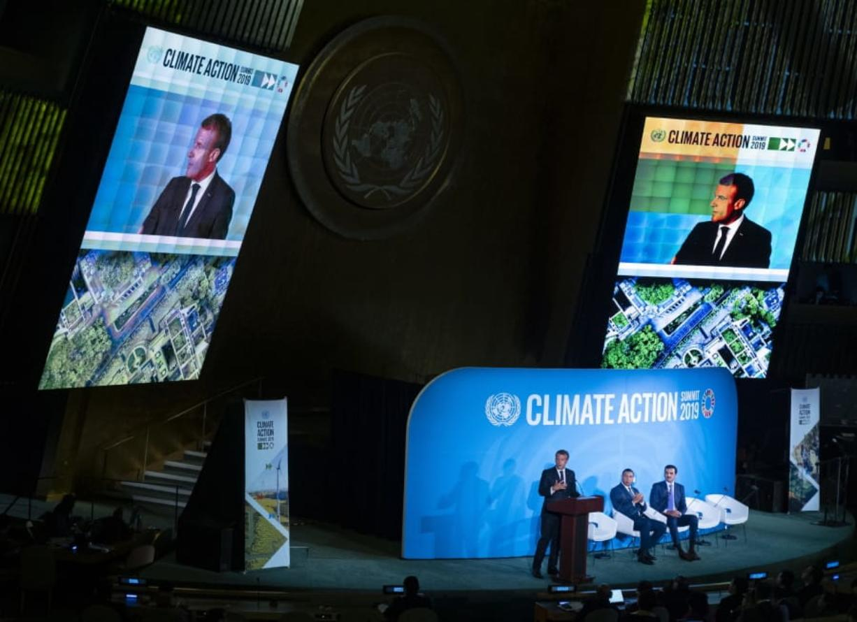 French President Emmanuel Macron speaks during the Climate Action Summit 2019 at the 74th session of the United Nations General Assembly, at U.N. headquarters, Monday, Sept. 23, 2019. Emir of Qatar, Sheikh Tamim bin Hamad Al Thani is center and Jamaica Prime Minister Andrew Holness is right. (AP Photo/Craig Ruttle) (Jason DeCrow/Associated Press)