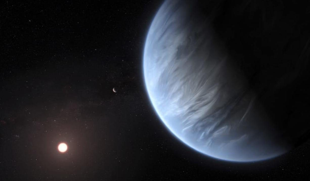 This artist's rendering shows Exoplanet K2-18b foreground its host star and an accompanying planet in this system. On Wednesday scientists announced they have discovered water on the planet outside our solar system that has temperatures suitable for