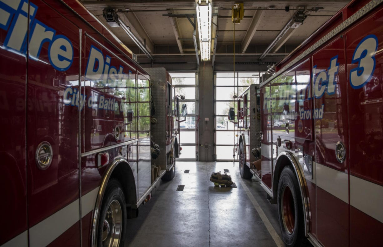 Fire District 3 trucks are parked in the garage at the station in Battle Ground in June. The Battle Ground City Council will let residents vote on whether the city should be annexed into Fire District 3 in the February election.