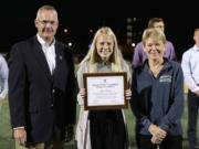 Jorie Freitag, center, was presented with the Granish Scholar Award by University of Rochester. Freitag captains in women's soccer team and is pursuing a degree in medicine.