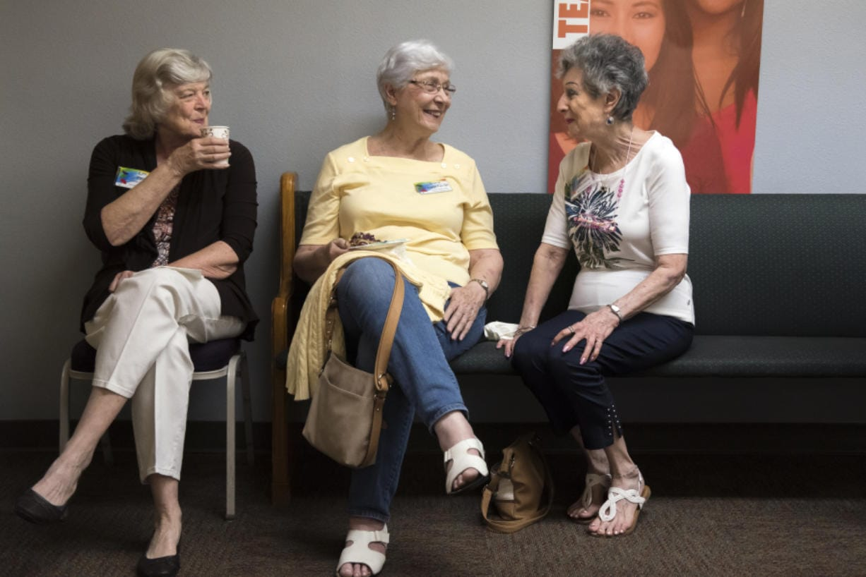 Lyn Farr, from left, Dorie Dageforde and Marian Sandler catch up before September's general meeting of the Clark County Newcomers Club at the YWCA Clark County.