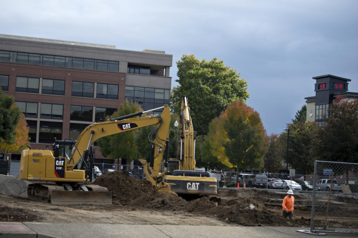 Construction is underway at the site for the new Al Angelo tower on Mill Plain Boulevard, which will add more office space to downtown Vancouver. (Amanda Cowan/The Columbian)