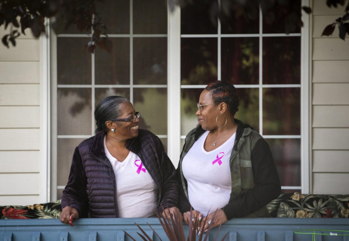 Della Frazier, left, and her daughter Zsaneen Kennedy, both of Vancouver, are pictured together Sept. 16 at Frazier's home. The mother and daughter were diagnosed with breast cancer in 2018. Both are now cancer-free. (alisha jucevic/The Columbian)