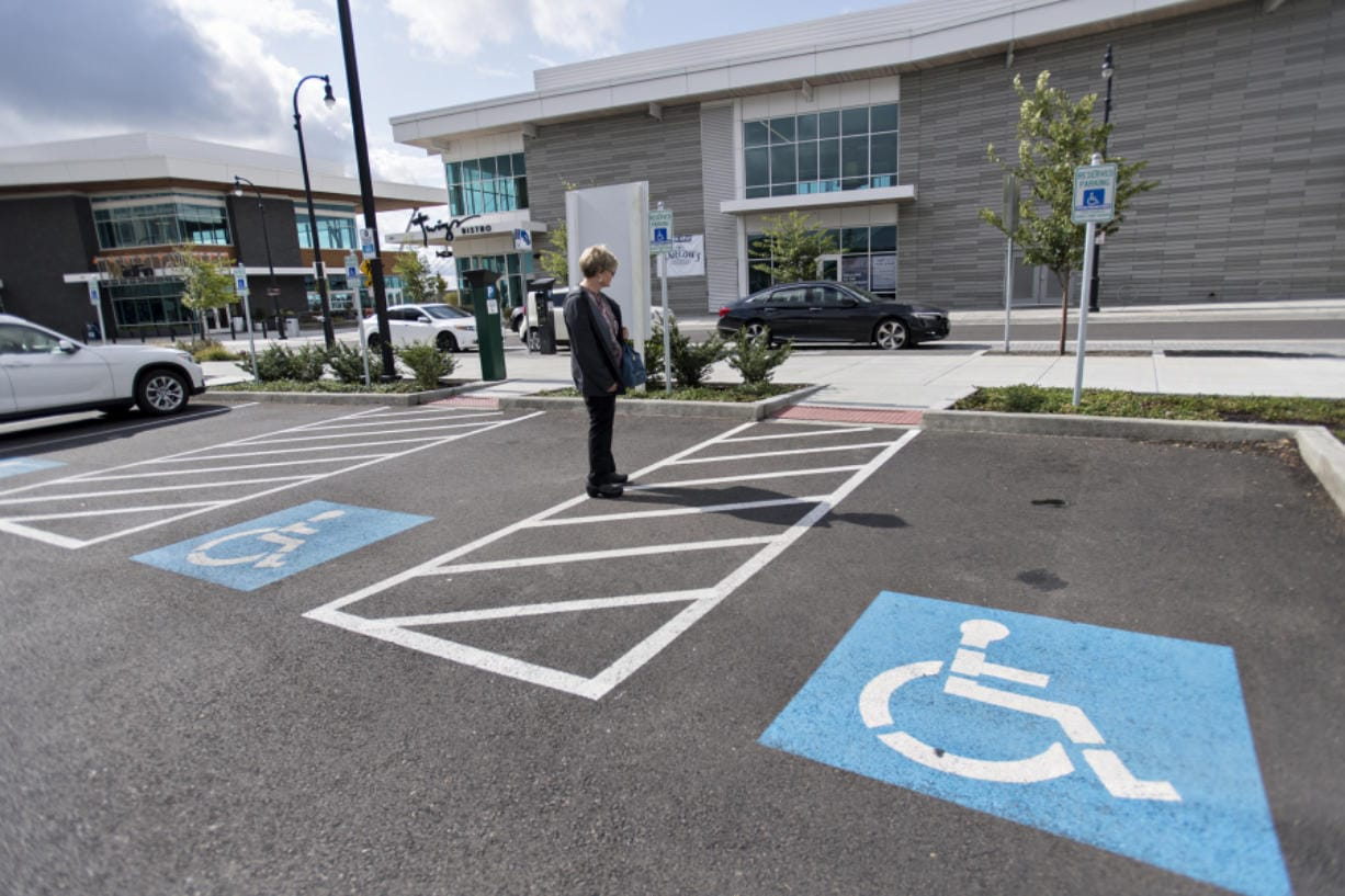 Helen Engel of Vancouver checks out the wheelchair-accessible parking spaces across from Twigs Bistro and Martini Bar at The Waterfront Vancouver.