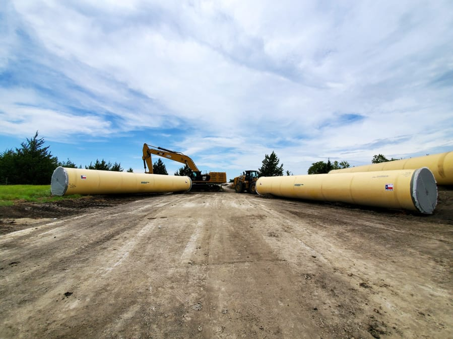 Northwest Pipe's spiral-welded steel pipe pieces are typically 50 feet in length and have a cement mortar lining and a polyurethane coating. The pipes pictured here are from the company's plant in Saginaw, Texas, which is supplying pipe for the Bois d'Arc Lake water project.
