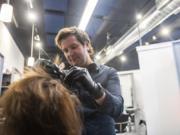 Grant Whitney, owner of Studio V, colors Gina Phillips' hair at his salon in Felida.