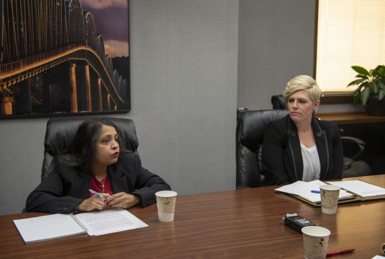 Evergreen School Board District 4 candidate Divya Jain, left, and incumbent Rachael Rogers, right, met with The Columbian's Editorial Board in Vancouver on Tuesday morning. Rogers was appointed to fill the seat in February to replace Todd Yuzuriha. (Alisha Jucevic/The Columbian)