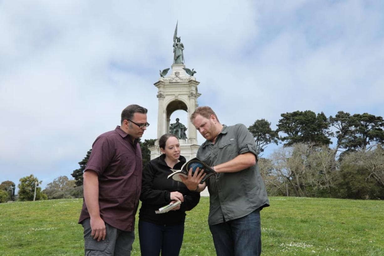 """Dustin and Diedra White of Vancouver, from left, consult with """"Expedition Unknown"""" host Josh Gates during the Oct."""