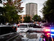Local law enforcement vehicles line up along Washington St. in downtown Vancouver as they work an active shooter situation at Smith Tower on Thursday afternoon, Oct. 3, 2019.